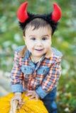 Child holding pumpkin. Halloween concept Stock Images