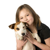 Child holding puppy Stock Images
