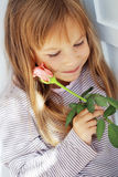 Child holding rose Stock Photos