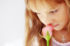 Child holding rose Stock Photo