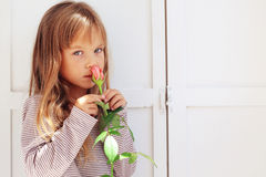 Child holding rose Stock Image
