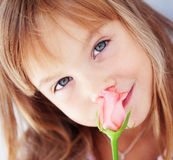 Child holding rose Royalty Free Stock Photos