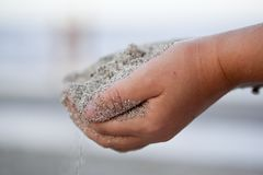 Child holding sand in the hands Royalty Free Stock Photo