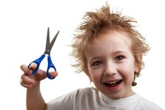 Child holding scissors Stock Image