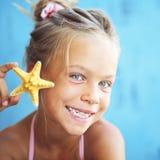 Child holding seashell Royalty Free Stock Images