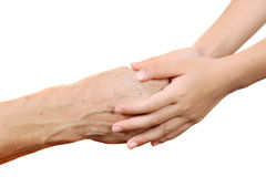 Child holding senior old woman by the hands isolated in the whit Stock Image