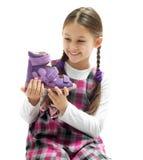 Child holding a shoe Royalty Free Stock Image