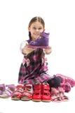 Child holding a shoe Stock Image
