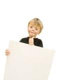 CHILD  HOLDING SIGN Stock Image