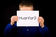 Child holding sign with Danish word Hvorfor  - Why Royalty Free Stock Image