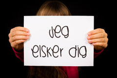 Child holding sign with Danish words Jeg Elsker Dig - I Love You Royalty Free Stock Image