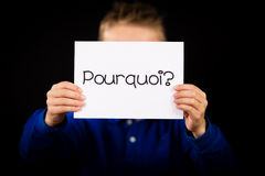 Child holding sign with French word Pourquoi - Why Royalty Free Stock Photos