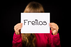 Child holding sign with German word Freilos - See You Later Stock Photos