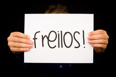 Child holding sign with German word Freilos - See You Later Stock Image
