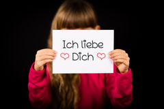 Child holding sign with German words Ich liebe Dich - I Love You Royalty Free Stock Photo