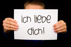 Child holding sign with German words Ich liebe Dich - I Love You Royalty Free Stock Image