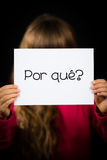 Child holding sign with Portuguese word Por Que - Why Royalty Free Stock Photo