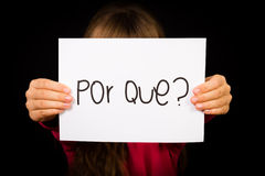 Child holding sign with Portuguese word Por Que - Why Stock Photography