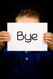 Child holding sign with Spanish word Bye which means See You Lat Stock Photography