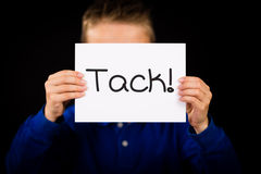 Child holding sign with Swedish word Tack - Thank You Stock Photos