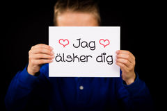 Child holding sign with Swedish words Jag Alsker Dig - I Love Yo Royalty Free Stock Photo