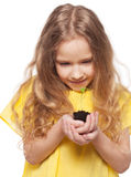 Child holding a sleedling Stock Photography