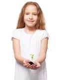 Child holding a sleedling Stock Photo