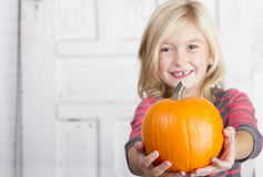 Child holding a small pumpkin Stock Photography