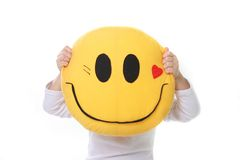 Child holding smiling pillow Stock Photos
