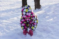 Child holding snow and playing on winter snowy day. On the nature. Royalty Free Stock Photos