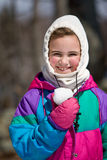 Child Holding Snowball Royalty Free Stock Photos