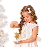 Child holding snowflake to decorate Christmas tree . Royalty Free Stock Photos