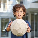 Child holding soccer ball Royalty Free Stock Photo