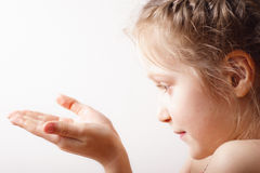 Child holding something shining Stock Image