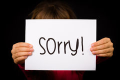Child holding Sorry sign Royalty Free Stock Image