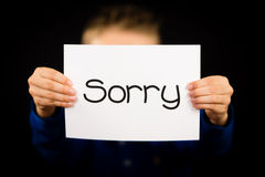Child holding Sorry sign Stock Photo