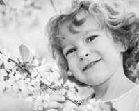 Child holding spring flower Stock Images