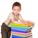 Child holding stack of books. Stock Photo