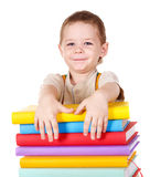 Child holding stack of books. Royalty Free Stock Photos