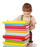 Child holding stack of books. Stock Image