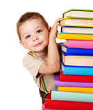 Child holding stack of books. Royalty Free Stock Images