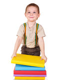 Child holding stack of books. Royalty Free Stock Photo