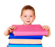 Child holding stack of books. Royalty Free Stock Image