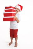 Child holding a stack of gift boxes Royalty Free Stock Photography