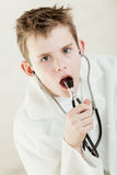 Child holding stethoscope near his mouth Stock Photos