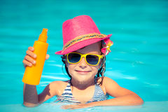 Child holding sunscreen lotion Royalty Free Stock Image