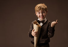 Child holding sweets Royalty Free Stock Photo