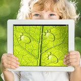 Child holding tablet PC stock images