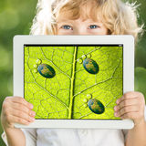 Child holding tablet PC Royalty Free Stock Image