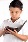 Child holding a tablet Royalty Free Stock Image